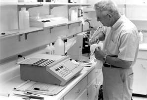 Clifford Hach working in lab
